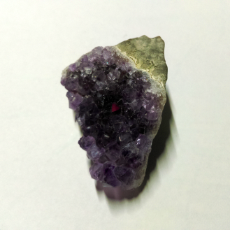 Natural amethyst with red flash